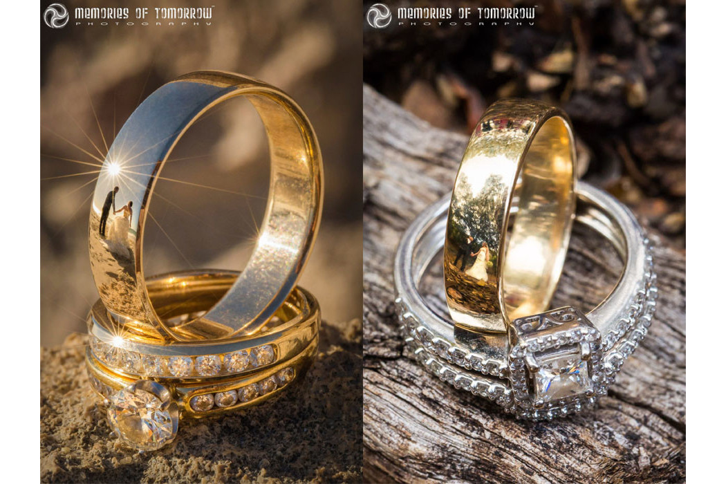 two sets of wedding rings photographed with a reflection of the couple in them