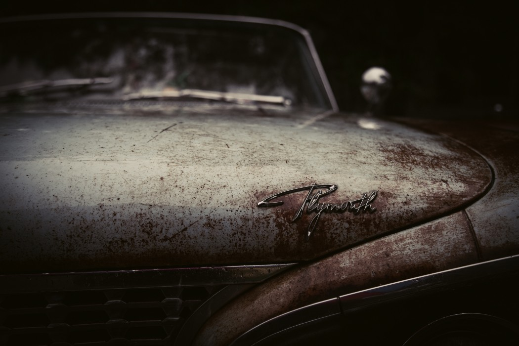 photo of a rusted plymouth