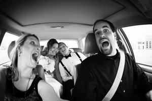 funny fish-eye shot of dave and whitney scott with a wedding couple