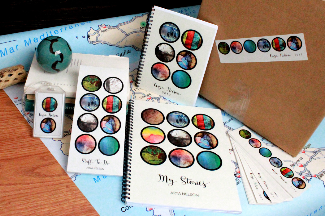 luggage tag, notepad, blank spiral-bound journal, spiral notebook, and bookmark sized stickers