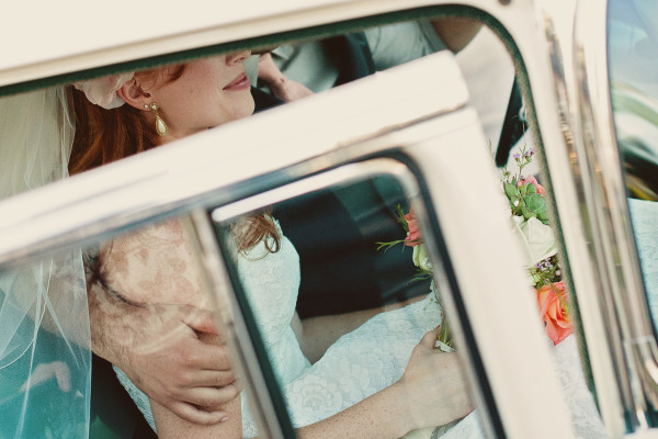 just married couple in a vintage car