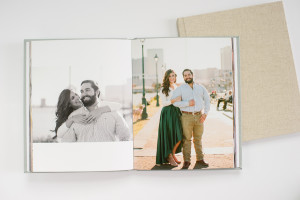 open photo book picturing a couple's engagement photos