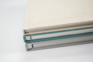 cloe-up of the spines of 3 fabric covered photo books