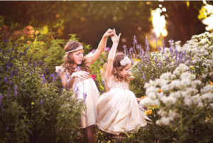 two sisters frolicking in a garden